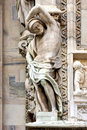 Church in milan incision italy statue of a men the front of the duomo and Royalty Free Stock Photos