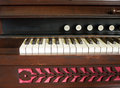 Church organ closeup a of one end of the keyboard and some of the tone buttons on a Stock Image