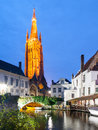 Church of Our Lady and bridge over water canal by night, Bruges, Belgium Royalty Free Stock Photo