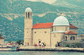 Church our lady of the rocks montenegro kotor bay july tourists in famous island with in kotor bay Royalty Free Stock Photos