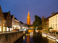 Church of Our Lady and water canal by night, Bruges, Belgium Royalty Free Stock Photo