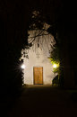 Church path at night tree hanging over Royalty Free Stock Image