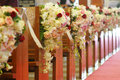 Church pews decorated with bouquets Stock Photography