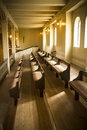 Church pews warm natural light on lines of at place of worship Stock Photos
