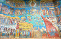 Church picture details voronet painted orthodox monastery in romania wall with scene from apocalypse episode Stock Image