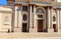 Church in piemonte front of a with walking nuns at alessandria cuneo italy Royalty Free Stock Image