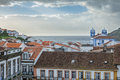 Church, roofs and ocean in Angra do Heroismo, Island of Terceira, Azores