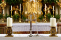 Church`s altar with crucifix and candles Royalty Free Stock Photo