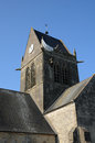 Church of sainte mere eglise in normandie france paratrooper on the Royalty Free Stock Images