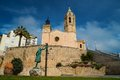 Church of sant bartomeu i santa tecla in sitges statue a woman against Royalty Free Stock Images