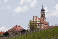 Church st johannis or johannes in castell germany evangelical lutheran of small bavarian village of rises above trees Royalty Free Stock Photos