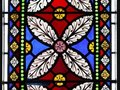 Church: stained glass window flower design Royalty Free Stock Photo