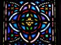 Church: stained glass window quatrefoil design Royalty Free Stock Photo