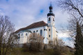 Church standing on a hill at lake Chiemsee in Bavaria Royalty Free Stock Photo