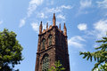 Church Steeple Against Blue Sky Background Stock Photos
