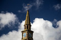 Church Steeple and Clock Against a Blue Cloudy Sky Royalty Free Stock Photo