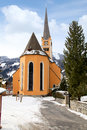 Church tower in Alpine village Bad Hofgastein , Austria. Royalty Free Stock Photo