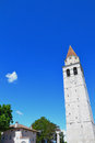 Church tower in aquileia italy with the clock bells and viewpoint for tourists against clear blue sky underneath the a landmark Stock Photography