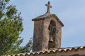 Church tower with bell in Spanish style Royalty Free Stock Photo