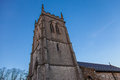 Church tower and blue sky Stock Photos