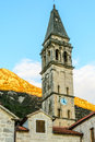 The church tower with a clock in the old town of perast montene Royalty Free Stock Photography