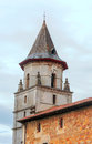 A church tower with clock in rocamadour france it is vertical image on cloudy day Royalty Free Stock Photos