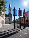 Church tower and flags in levoca summer view portraying of historical with of european union slovakia flag of town Royalty Free Stock Photography