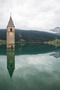 Church tower of Lago di Resia in Curon Venosta Royalty Free Stock Photo
