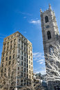 Church tower and old skyscrapper building Royalty Free Stock Images