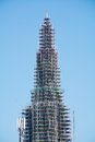 Church tower with scaffolding against blue sky Royalty Free Stock Photo