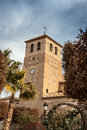 Church tower in spain stone of a almeria Stock Photo