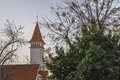Church Tower Surrounded by Trees Against Sky Royalty Free Stock Photo
