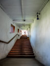 Church tunnel with stairs leading to garden Royalty Free Stock Photo