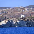 Church and village on greek island scenic view of traditional white homes hillside of with blue sea in foreground greece Royalty Free Stock Photography
