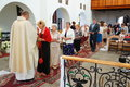 Church visitors and priest row of standing on the line by an in a in poznan poland Stock Images