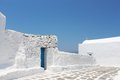 Church wall greece white and with beautiful blue sky Stock Photos