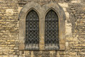 Church windows with bars Royalty Free Stock Photo