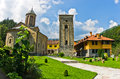 Church yard inside 13th century Rača monastery walls Royalty Free Stock Photo