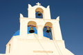 Churchbells of the famous blue domed church close view bells over caldera in oia santorini thira greece at dawn Royalty Free Stock Images