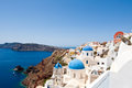 Churches on the edge of the caldera on the island of Santorini, Greece. Royalty Free Stock Photo