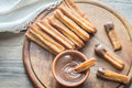 Churros - famous Spanish dessert with chocolate sauce Royalty Free Stock Photo