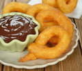Churros spanish with chocolate on brown background closeup Stock Image