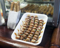 Churros a styrofoam plate of chocolate covered mexican fried dough called Royalty Free Stock Images