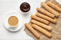 Churros traditional Spain street fast food baked sweet dough snack with chocolate and coffee Royalty Free Stock Photo