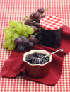 Chutney of red and white grapes made ​​of in the pot on a napkin with in the background Royalty Free Stock Images