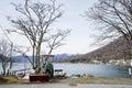 Chuzenji lake with leafless trees and used wheel loader
