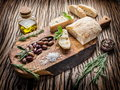 Ciabatta olives and blue cheese on the wood Royalty Free Stock Photography