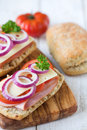 Ciabatta open sandwiches bread with ham cheese tomato red onion shallow dof Stock Image