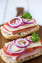 Ciabatta open sandwiches bread with ham cheese tomato red onion shallow dof Royalty Free Stock Image