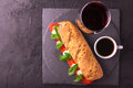 Ciabatta sandwich with caprese salad with wine and coffee. Royalty Free Stock Photo